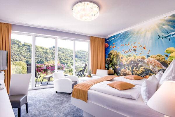 Krähennest Doppelzimmer Deluxe Zimmeransicht mit Balkon